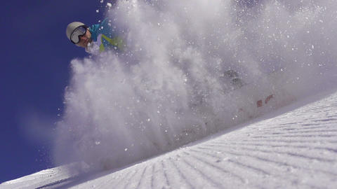 SLOW MOTION: Snowboarder spraying snow into the ca Footage