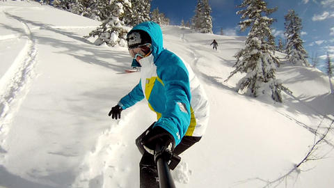 Snowboarder riding powder Footage