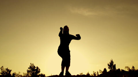 SLOW MOTION: young women jumping at sunset Footage