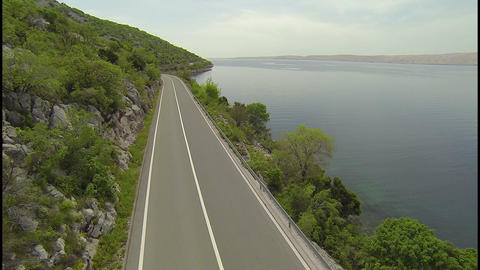 AERIAL: Empty road along the mediterranean beach Live Action