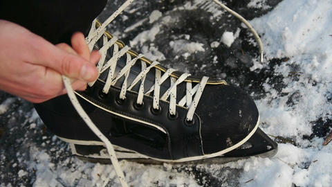 Lacing ice skates Live Action