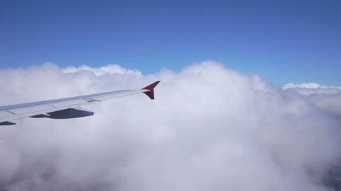 Airplane Flying Through The Clouds stock footage
