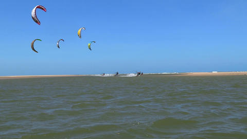 Kitesurfers riding towards the camera Footage
