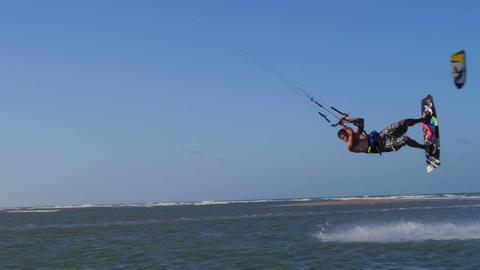 Kiteborder jumping and spinning Footage