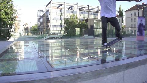 Skateboarder does manual trick Footage