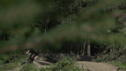 SLOW MOTION: Bmx biker riding a wheelie Footage