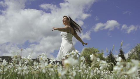 SLOW MOTION: Woman enjoying in blooming spring Live Action