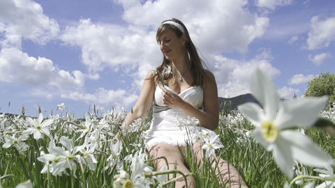 SLOW MOTION: Young woman gathering flowers Footage