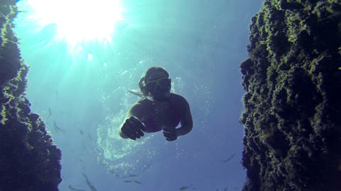 UNDERWATER: Young woman diving Footage
