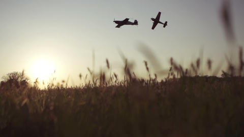 SLOW MOTION: Aerobatic airplanes flying Footage