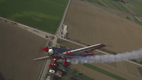 SLOW MOTION: Aerobatic aircraft flying above the f Live Action