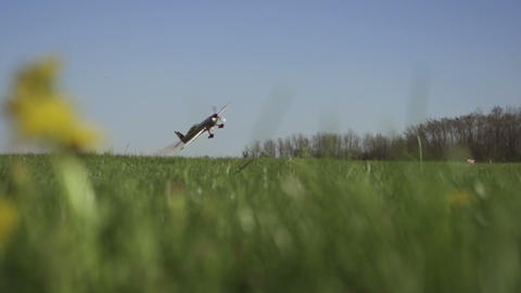 SLOW MOTION: Aerobatic aircraft flying low Footage