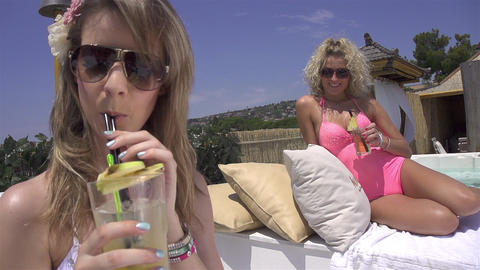 SLOW MOTION: Attractive women sipping cocktails Footage