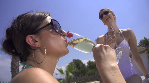 SLOW MOTION: Drinking champagne poolside Footage