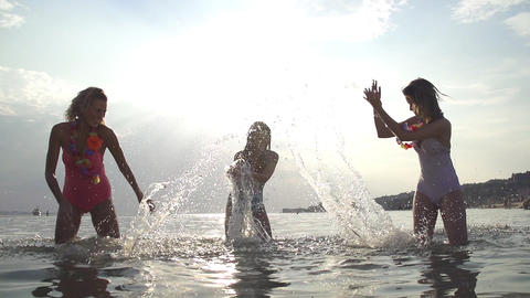 SLOW MOTION: Women splashing water into eachother Footage