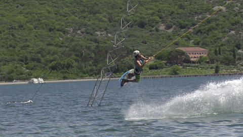 SLOW MOTION: Professional wakeboarder jumps high Footage