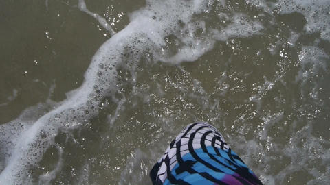 Walking on the beach with the sound of the waves Footage
