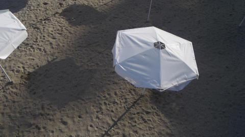 AERIAL: White Umbrellas On The Beach stock footage