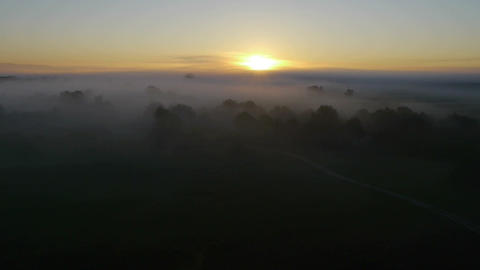 Rising up over a morning mist Footage