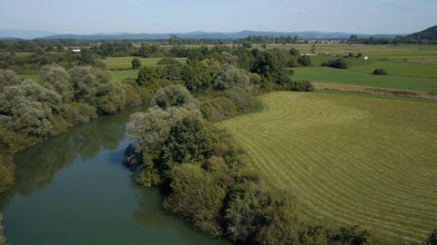AERIAL: River and fields Footage