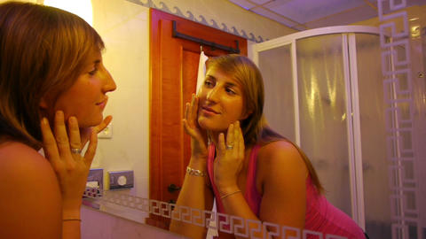 Girl Checking Her Skin In The Mirror stock footage