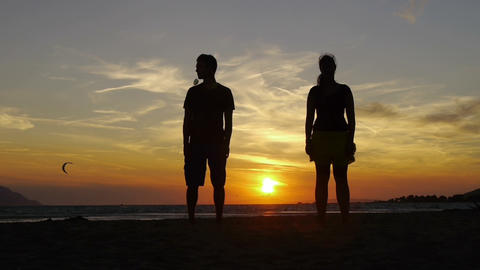 Couple jumping at sunset Footage