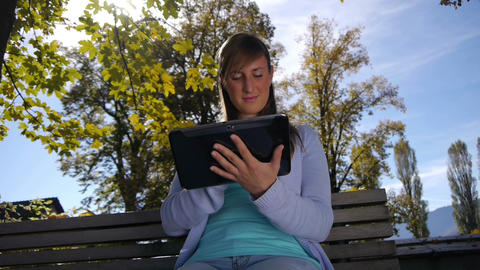 DOLLY: Digital tablet in nature Footage