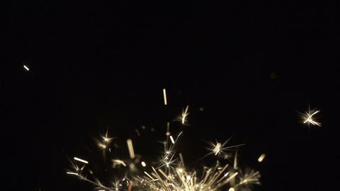 SLOW MOTION: Golden sparkle Footage