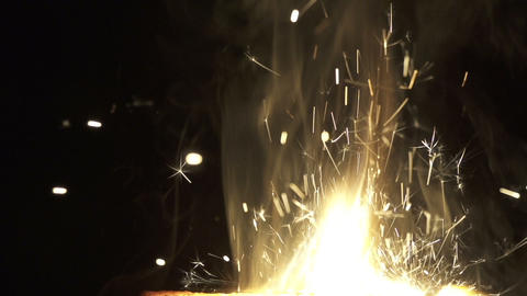 SLOW MOTION: Fire and golden sparkles Footage