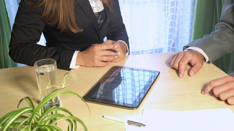 Businessman and businesswoman discussing and signi Footage