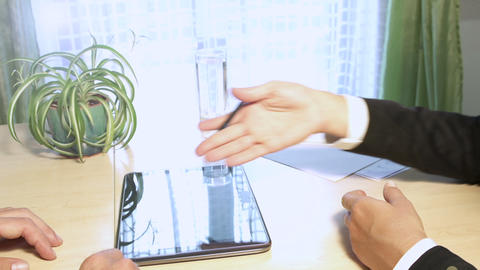 Businessman And Businesswoman Signing Contract On  stock footage