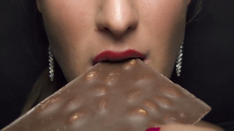 SLOW MOTION: Woman eating chocolate Footage