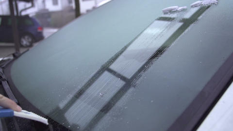 SLOW MOTION: Scraping frosted windshield Footage