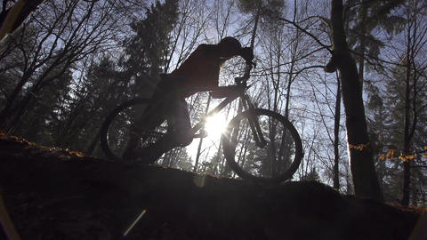 SLOW MOTION: Mountain biker going uphill Footage