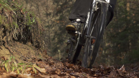SLOW MOTION: Mountain biker braking in a turn Footage