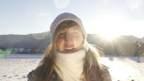 SLOW MOTION: Young woman blowing snow Footage