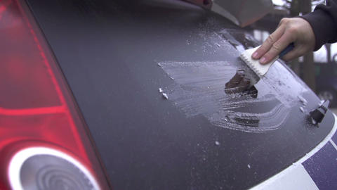 SLOW MOTION: Scraping frosted car Footage
