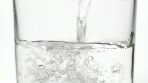 SLOW MOTION: Pouring water into the glass Footage