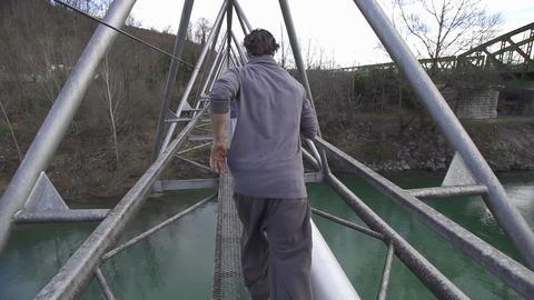 SLOW MOTION: Running across the bridge Footage