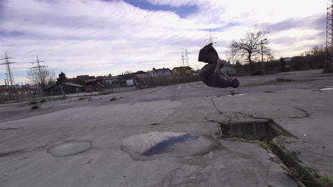 SLOW MOTION: Free runner does front flip into the  Footage