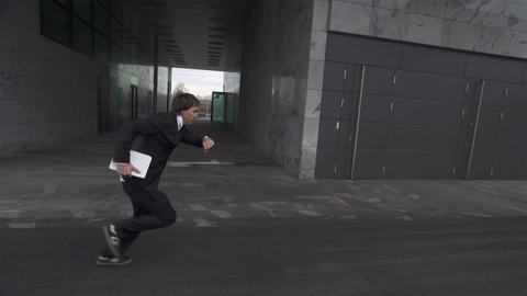 SLOW MOTION: late businessman rushing to work Footage