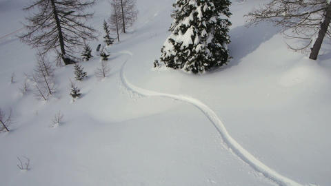 AERIAL: Snowboarder riding powder Footage