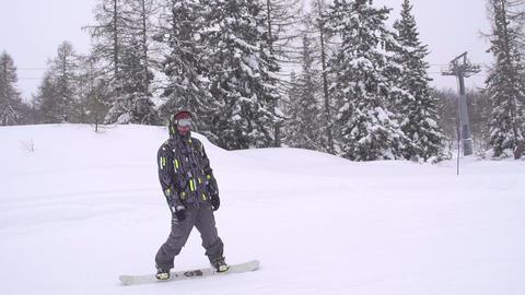 SLOW MOTION: Snowboarding on ski slope Footage