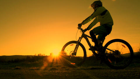SLOW MOTION: mountain biker pulls a wheelie Footage