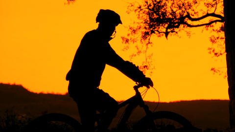 PORTRAIT: Mountain biker silhouette Footage