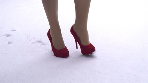 SLOW MOTION: Woman In Red High Heels Walking In Sn stock footage