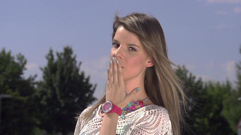 SLOW MOTION: Sensual lady sending a kiss Footage