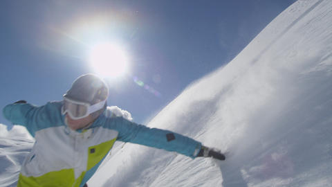 SLOW MOTION: Snowboarder rides pass the camera Footage