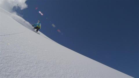 SLOW MOTION: Snowboarder rides powder in European  Footage