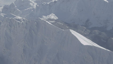AERIAL: Flying over snowy mountains Footage